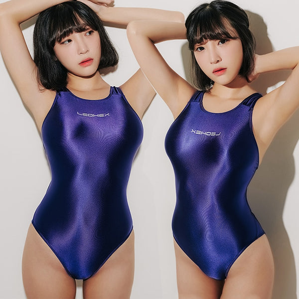 front view of lady wearing dark Blue wet look swimsuit featuring a scoop neck, cut out back, high cut sides and a brief cut.