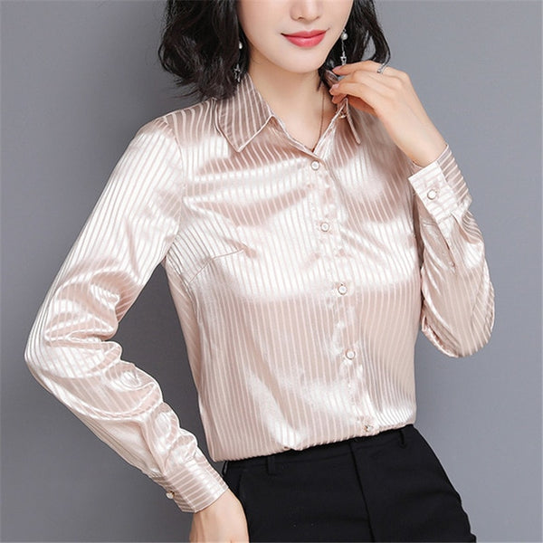 Apricot satin blouse featuring long sleeves, button down closure, stripes detailing and a fitted silhouette.