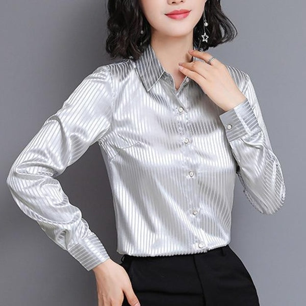 Grey satin blouse featuring long sleeves, button down closure, stripes detailing and a fitted silhouette.