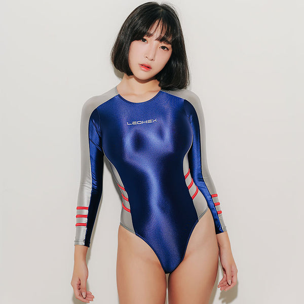 Blue wet look Leotard body hugging yet stretchable, featuring long sleeves, scoop neckline and a cheeky cut back.