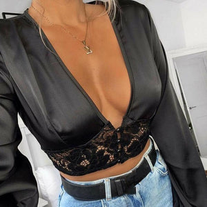 Black satin blouse featuring long sleeves, plunging neckline, front lace panel with front button closure.