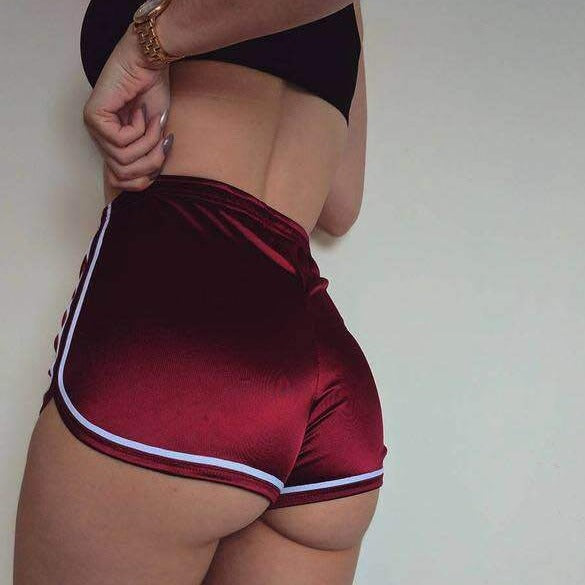 Burgundy silky high waisted booty shorts featuring a elastic waistband, white edging line that accentuate your butt, comfortable and stretchy.