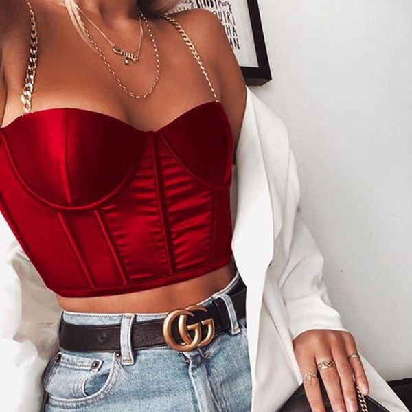 Red sexy corset crop top featuring a adjustable shoulder straps, back zipper closure and a low cut back.