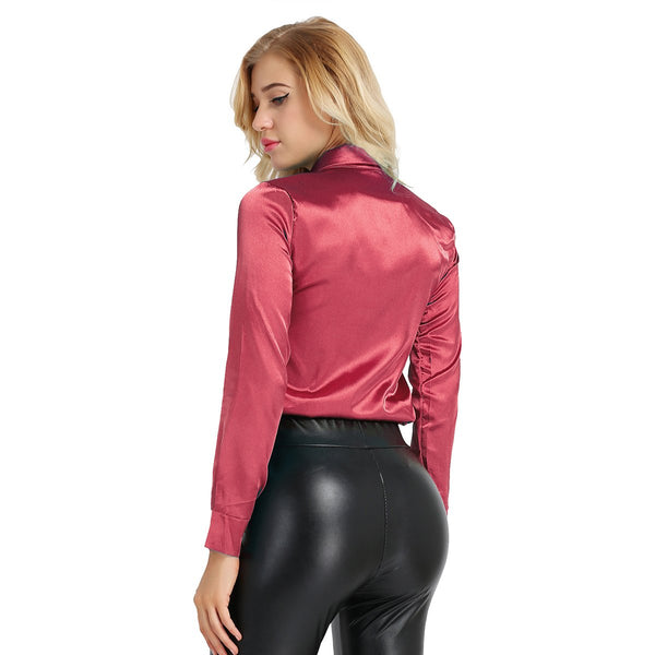 Maroon satin blouse featuring button down closure, long sleeves, fitted silhouette.