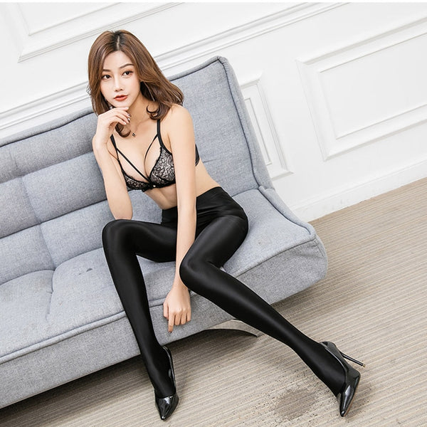 Black opaque shiny pantyhose legging with elastic waist band and a high waisted silhouette
