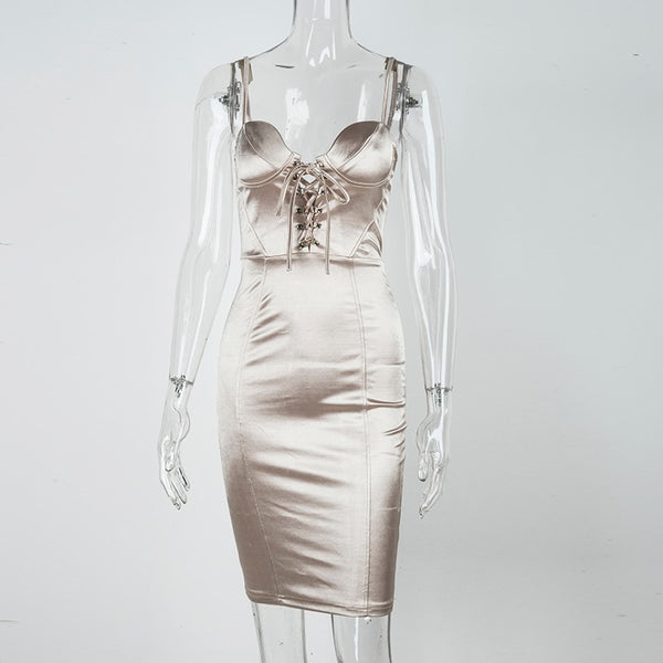 front view of a champagne color satin dress featuring a V-neckline with lace-up detail and adjustable shoulder straps.