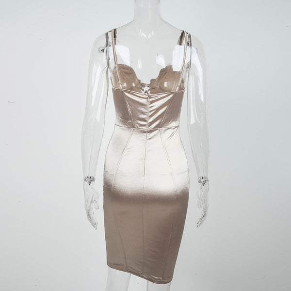 back view of a champagne color satin dress featuring a V-neckline with lace-up detail and adjustable shoulder straps.