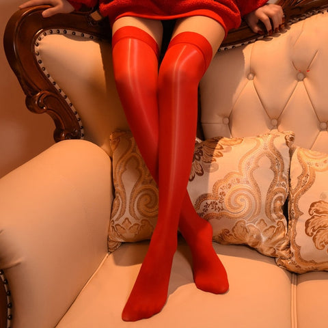 Red 8 denier sheer shiny thigh high stockings with solid leg band