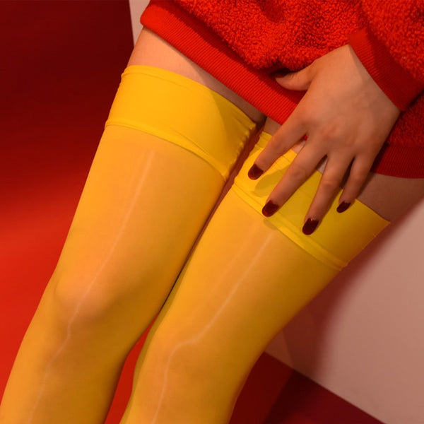 Yellow 8 denier sheer shiny thigh high stockings with solid leg band