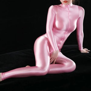 pink shiny bodysuit featuring a front zipper closure, long sleeves, and a high neckline.