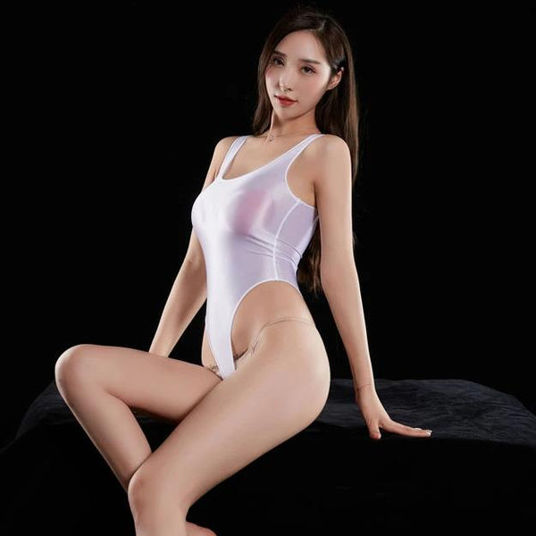 White wet look bodysuit featuring a scoop neckline, thick shoulder straps, arousing smooth to the touch fabric, high cut sides and a thong cut back.