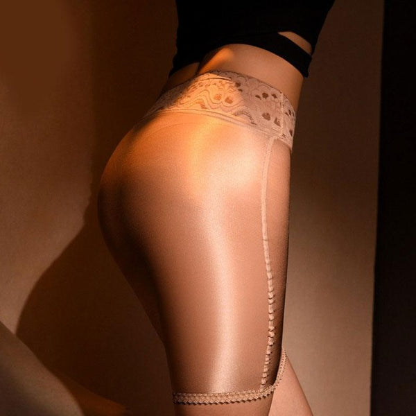 Beige sheer mini skirt featuring a lace waistband and sensual shiny nylon.