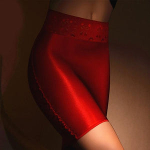 Red sheer mini skirt featuring a lace waistband and sensual shiny nylon.