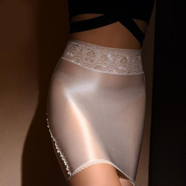 White sheer mini skirt featuring a lace waistband and sensual shiny nylon.
