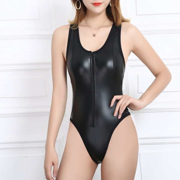 front view of lady wearing a black wet look bodysuit featuring a scoop neckline, front zipper closure, high cut sides and a cheeky cut back.