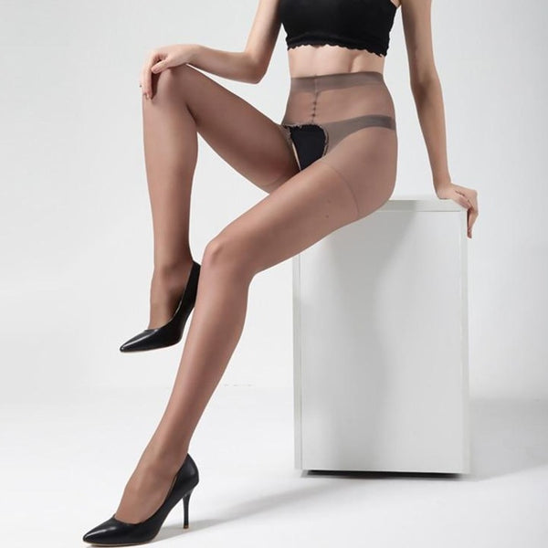 front view of lady wearing a brown sheer open crotch pantyhose with black panty and black high heels