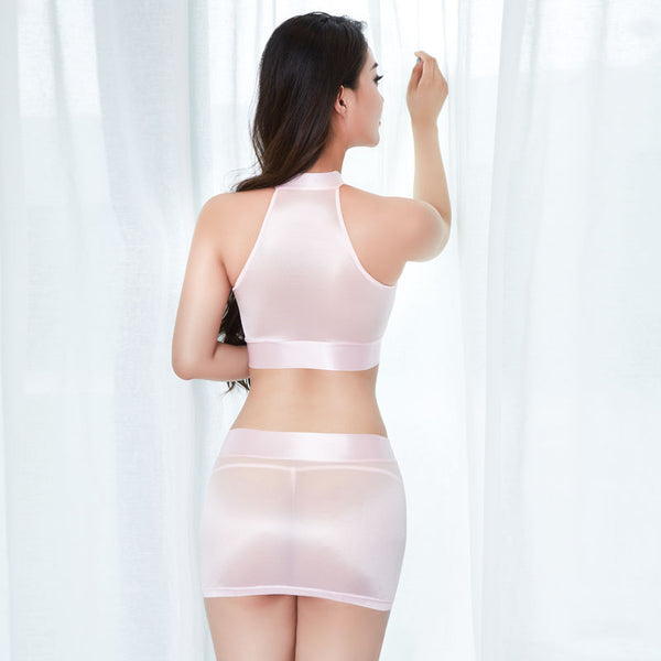 back view of lady wearing pink sheer shiny crop top with matching sheer shiny mini skirt