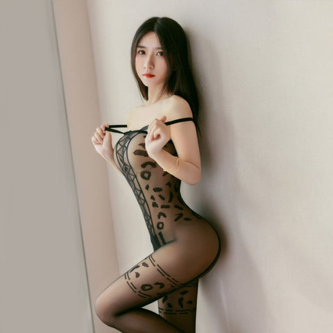 side view of lady wearing black bodystocking featuring spaghetti straps, square neckline, leopard print, and an open crotch.