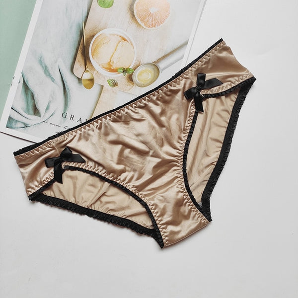 champagne color panty featuring satin front bow accent