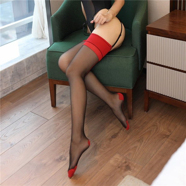 side view of lady wearing sheer thigh high stockings with red solid leg band with reinforced toe and heel showing off her feet