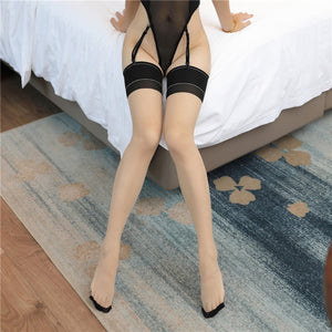 front view of lady wearing sheer thigh high stockings with black solid leg band with reinforced toe and heel showing off her feet