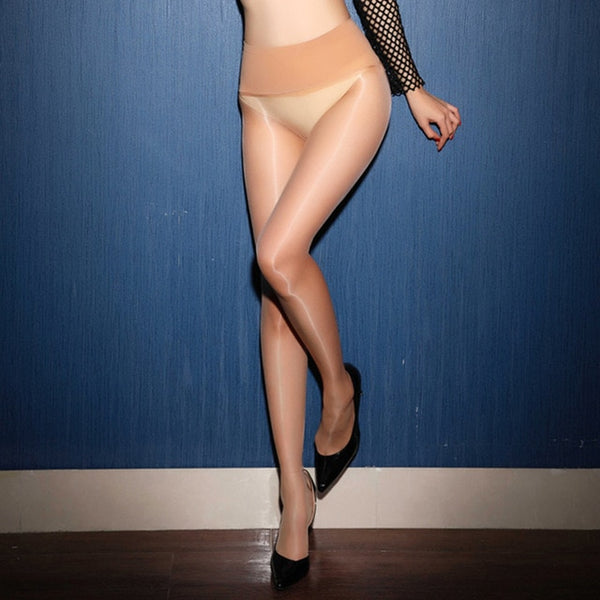 front view of lady wearing beige glossy sheer pantyhose with solid wide waist band with black high heels