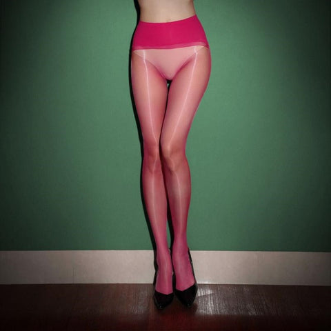 front view of lady wearing pink glossy sheer pantyhose with solid wide waist band with black high heels