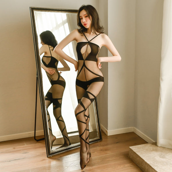 front view of lady wearing black sheer bodystocking featuring a halter neck, bust keyhole silhouette, criss cross thigh high detailing, a scoop back and an open crotch showing off her feet