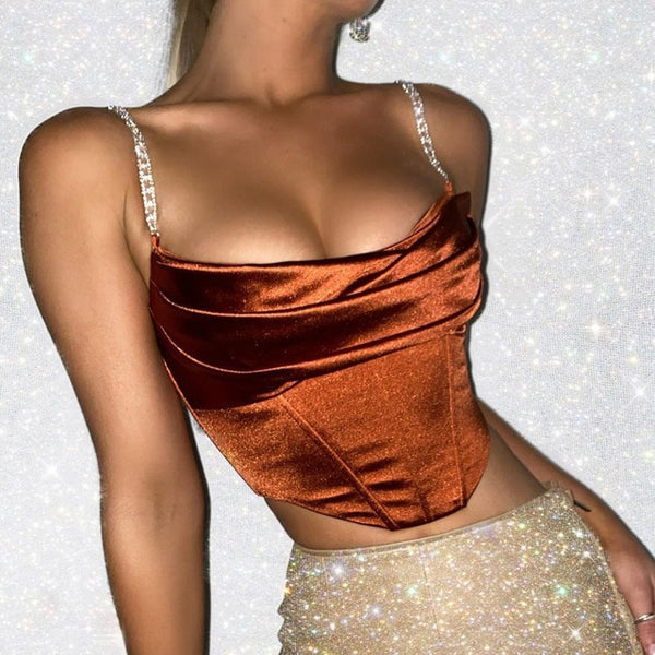front view of lady wearing cinnamon color corset crop top that shows off your luscious curves featuring adjustable chain link shoulder straps, a scoop neckline, and back zip closure.