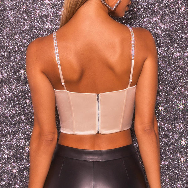back view of lady wearing pink color corset crop top that shows off your luscious curves featuring adjustable chain link shoulder straps, a scoop neckline, and back zip closure.