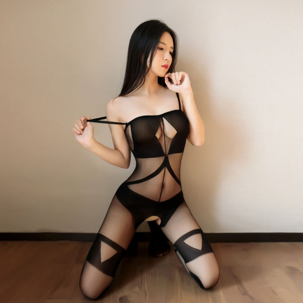 front view of lady wearing a black bodystocking, featuring spaghetti straps, opaque cups, square neckline, criss-cross embroided thigh high stockings, and an open crotch.