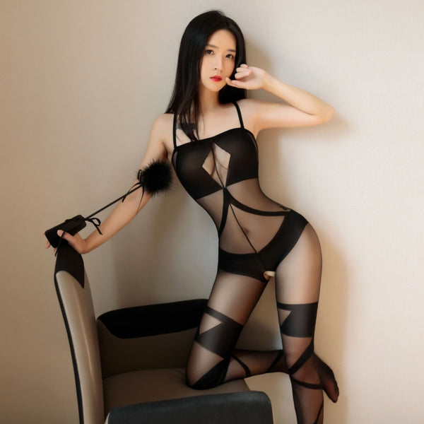 front view of lady wearing a black bodystocking, featuring spaghetti straps, opaque cups, square neckline, criss-cross embroided thigh high stockings, and an open crotch, showing off her feet