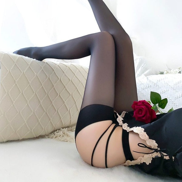 side view of lady wearing black sheer pantyhose features a strappy waist band, and an open crotch.
