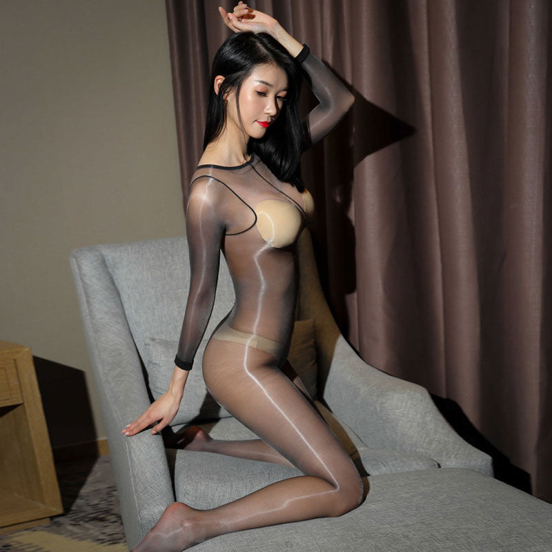 side view of lady wearing black shiny bodystocking featuring long sleeves, scoop neckline, choice of either closed crotch or open crotch showing off her feet