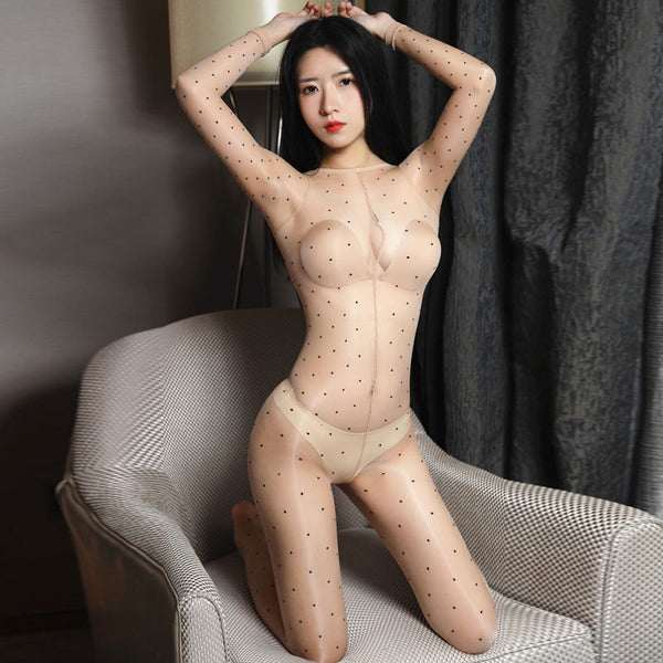 front view of lady wearing beige shiny bodystocking featuring long sleeves, scoop neckline, all round polka dot print, showing off her feet