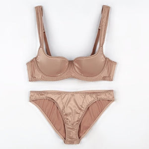 Beige satin bra set featuring underwire cups, thick adjustable shoulder straps, back eye and hook closure, and a matching panty.