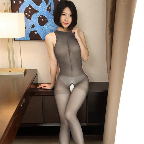 front view of lady wearing gray high neck sheer bodystocking, featuring an open crotch, open side panels.