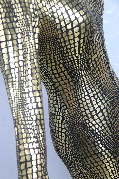 Gold Unleashed the animal in you with this catsuit featuring a front zipper closure, scaled inspired design, long sleeve.