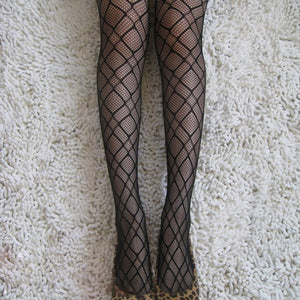 Black pantyhose features a netted pattern that goes well with any outfit.
