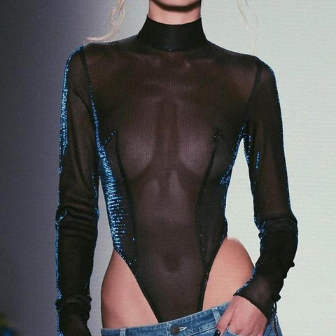 bodysuit featuring a high neckline, long sleeves, mesh bodice, high cut sides and a thong cut back.