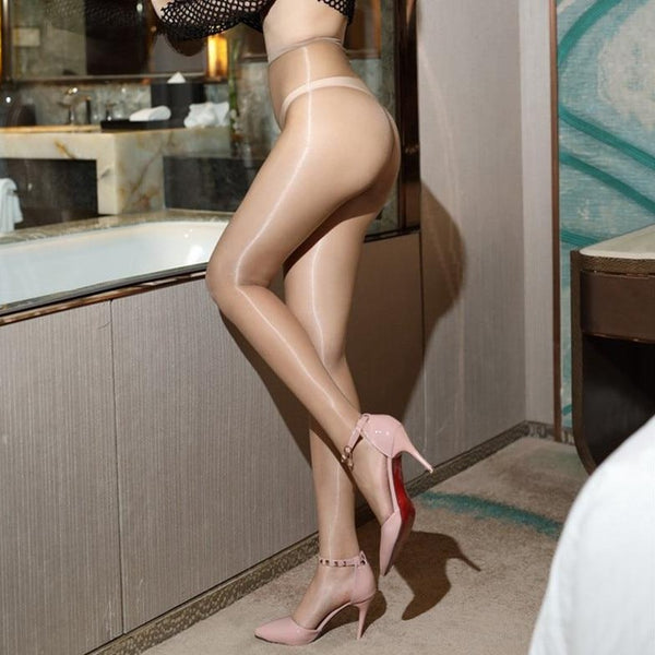 side view of lady wearing skin color 1 denier glossy sheer pantyhose with high heels