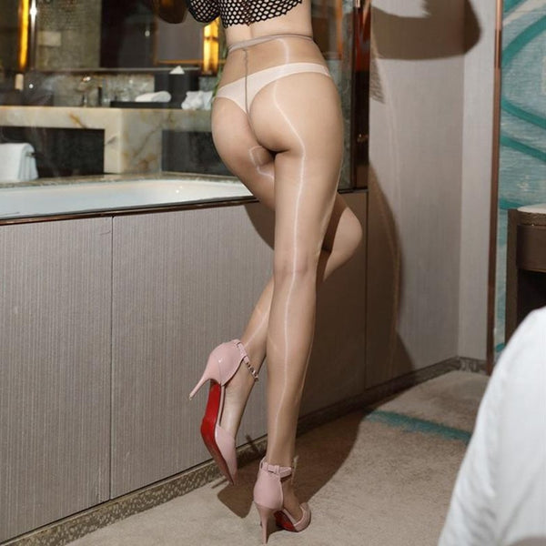 back view of lady wearing skin color 1 denier glossy sheer pantyhose with high heels
