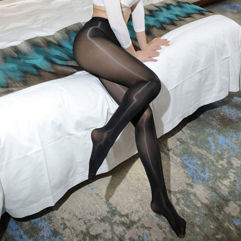 front side view of lady wearing black 8 Denier Glossy Shiny Sheer Pantyhose showing off her feet