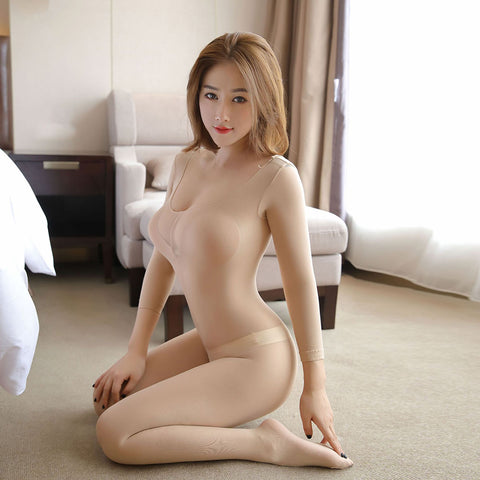 front view of lady wearing a beige color bodystocking, featuring long sleeves, scoop neck and an open crotch.
