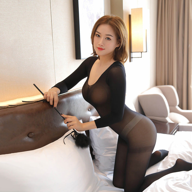 front side view of lady wearing black bodystocking, featuring long sleeves, scoop neck and an open crotch.