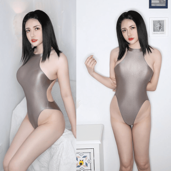front view of lady wearing a grey color wet look bodysuit featuring a high neck, large back keyhole, high cut sides and a cheeky cut back.