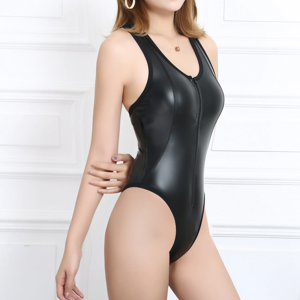 side view of lady wearing a black wet look bodysuit featuring a scoop neckline, front zipper closure, high cut sides and a cheeky cut back.