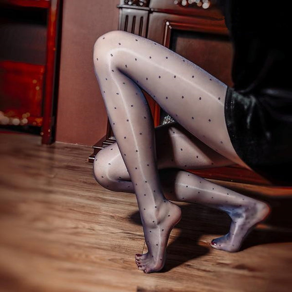 side view of lady wearing blue color shiny sheer pantyhose with polka dot prints showing off her feet