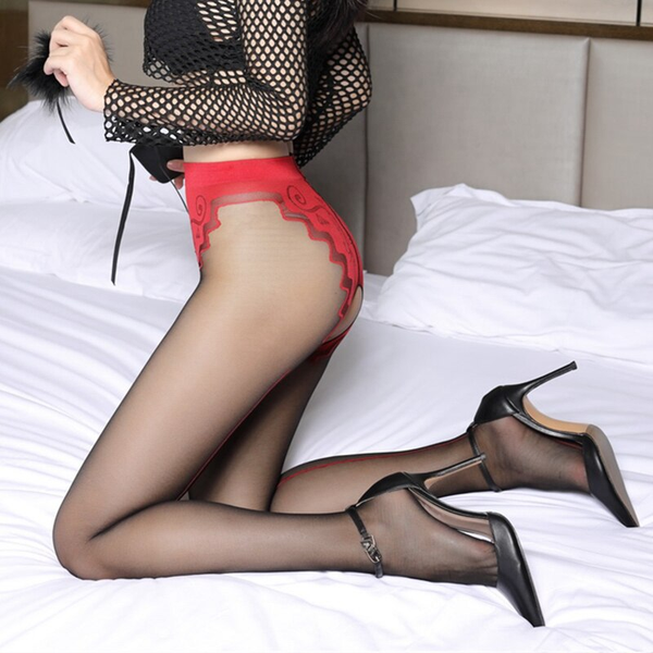 side view of lady wearing red and black pantyhose featuring a classic back seam, an open crotch, and a panty silhouette with intricate floral design with black high heel