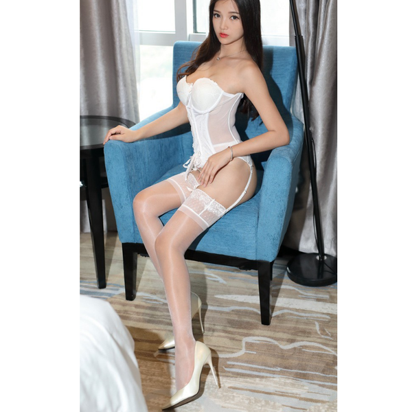 front view of lady wearing white corset top with white shiny lace thigh high stocking with white high heels